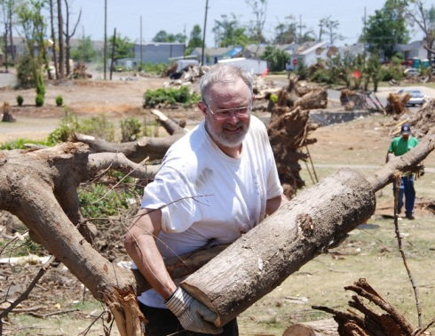 Out-of-shape blogger helps remove tornado debris in Tuscaloosa in the kind of heat he'd forgotten existed. (Photo by my father, Charlie Land.)