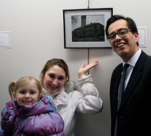 Elena and daughter with Esteban with her photo at February 2012 exhibit.
