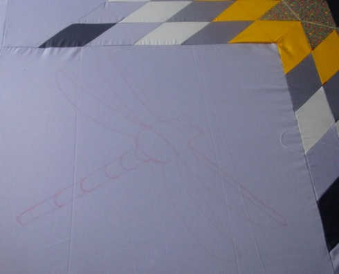 Outline where dragon fly was to be sewn on the Lakota star quilt.