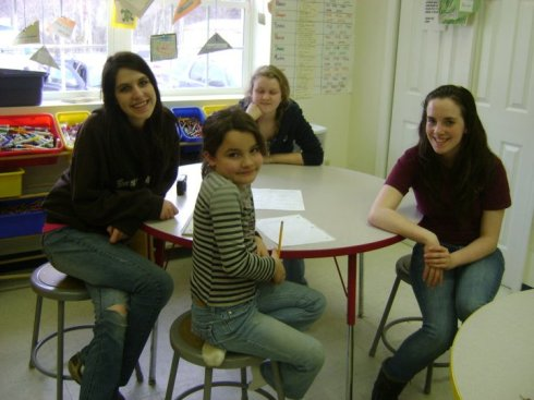 Olivia Mandile (left) sharing good times on West Virginia mission trip.