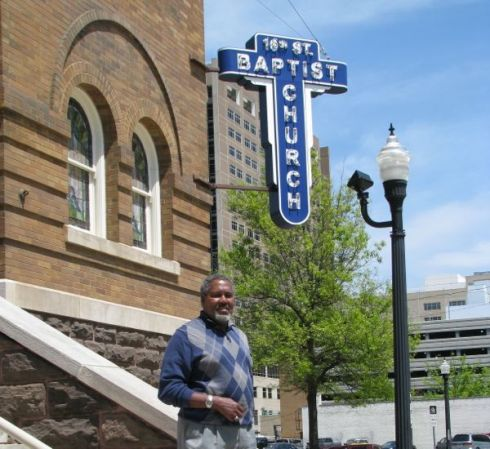 Church administrator Washington on steps of 16th Street Baptist.