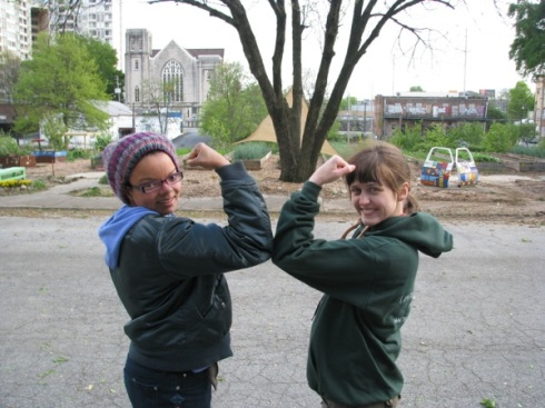 Joya and Kelley show off the biceps of veteran gardeners.