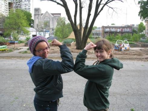 Joya and Kelley show off the biceps of veteran gardeners.