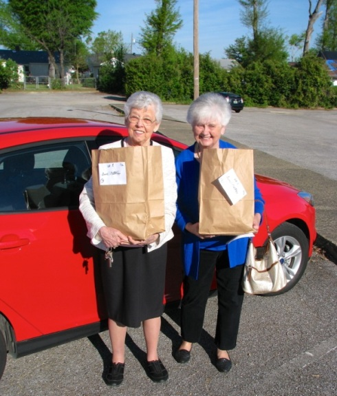 Mom, right, and Charlotte make their Meals on Wheels run Easter morn.