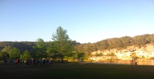 Hundred or so sixth-graders cross the riverside field where I once played volleyball with my future pastor/boss.