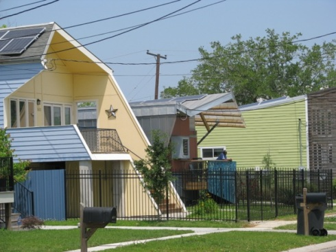The homes built by Pitt's foundation incorporate solar tiles, as well as other modern elements.