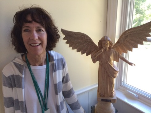 Kathleen with angel in the sanctuary at George Mark Children's House.